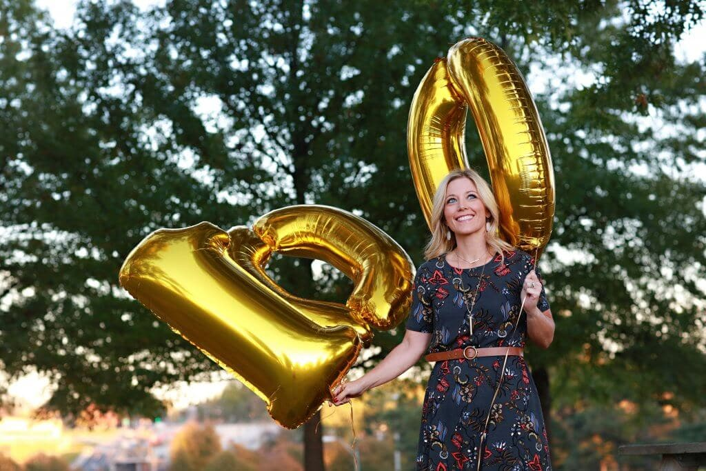 Woman holding balloons after losing 100 pounds