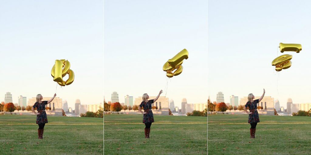 Woman releasing balloons after losing 100 pounds