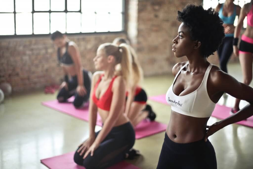 A group exercise class on yoga mats