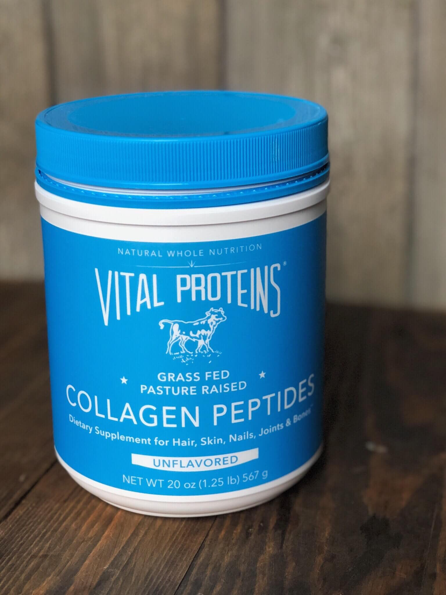 A canister of vital proteins collagen peptides on a wood background