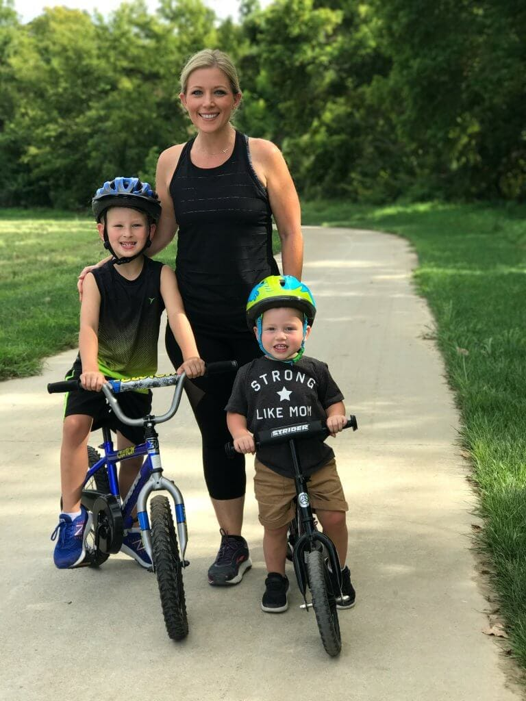 A woman with her two sons on bikes