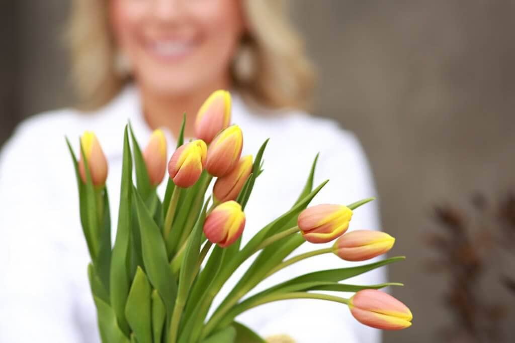 Woman holding tulips in hand