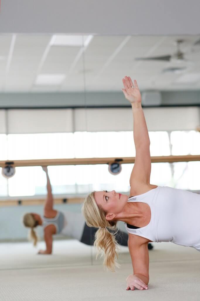 Woman in a side plank in her workout