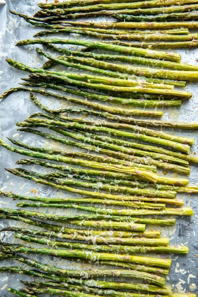 Oven Roasted Garlic Parmesan Asparagus laying on a sheet pan
