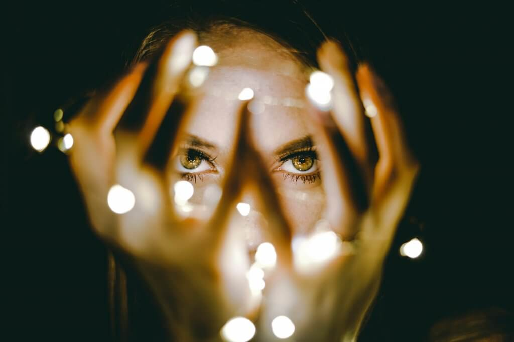 Woman holding lights in her hand