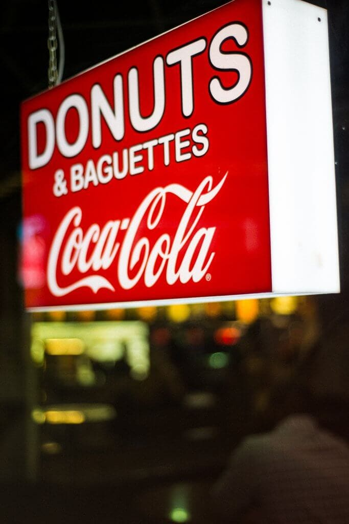 Donuts sign and diet coke sign