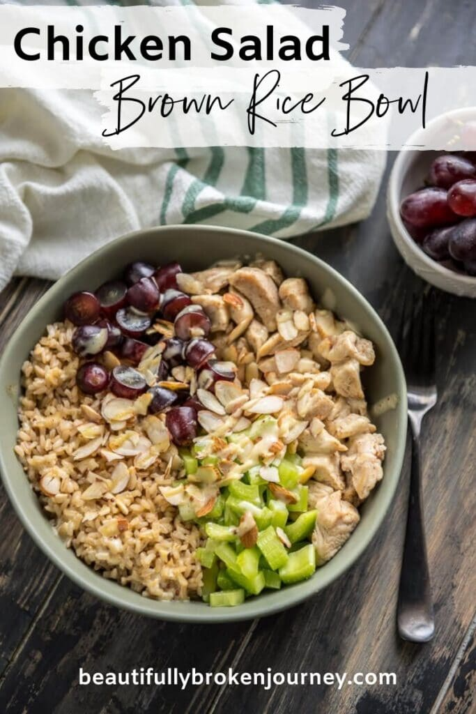 Chicken Salad in a grey bowl with celery, almonds and grapes