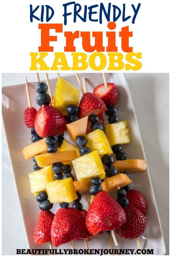 Easy and delicious Kid Friendly Fruit Kabobs are great to get your kids involved in the kitchen and also can be a great appetizer! #fruitkabobs #fruit #strawberries #blueberries #pineapple #healthysnacks #healthyrecipes #kabobs #fruitrecipes