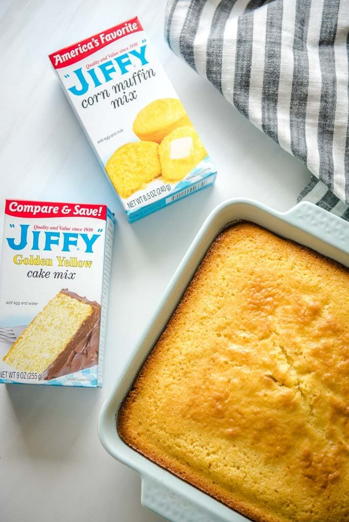 Two boxes of Jiffy mix and a pan of cornbread and a napkin