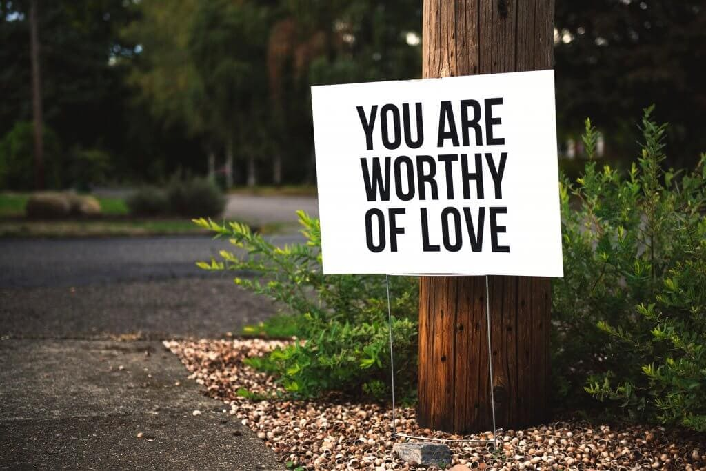 "A sign that says ""you are worthy of love"""