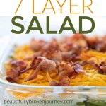 A family favorite recipe! My Mom's 7 Layer Salad is perfect for a get together for a fresh and crisp side dish! #layersalad #7layersalad
