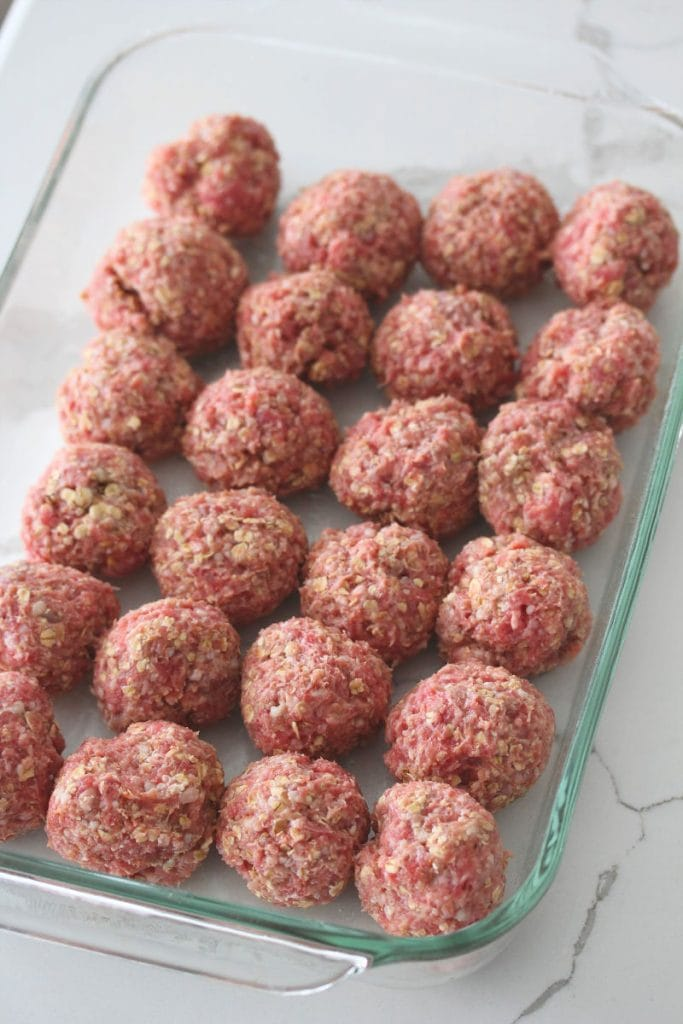 Raw BBQ Meatballs before adding on the bbq sauce in a 9x13 baking dish