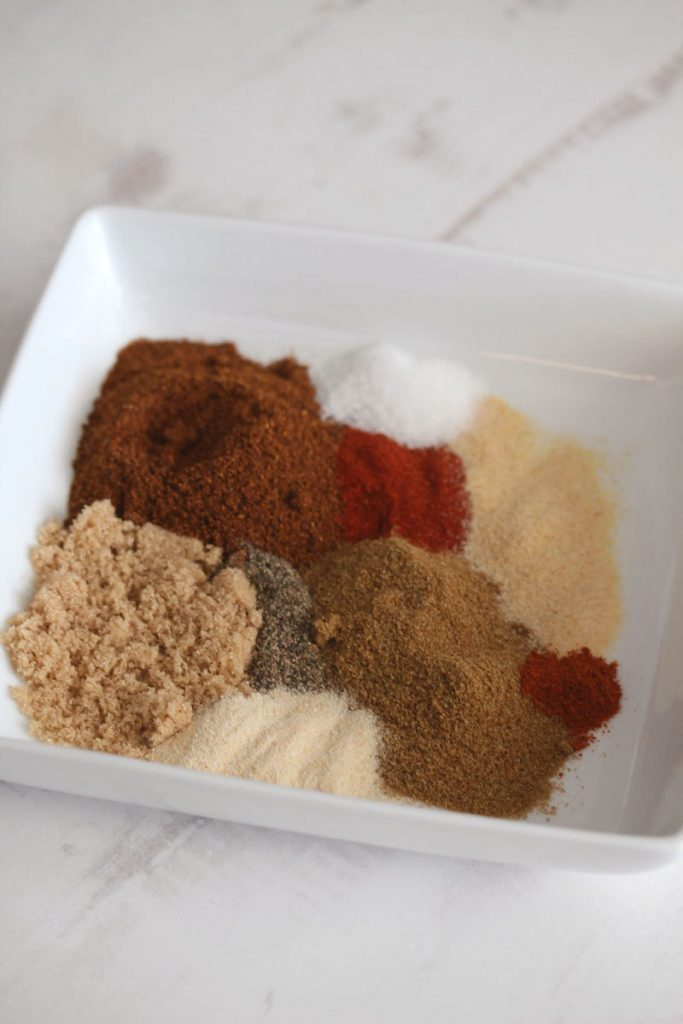 picture of spices for chili seasoning in a flat white bowl