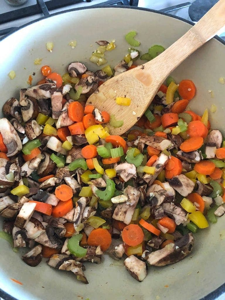 Chopped vegetables in a dutch oven