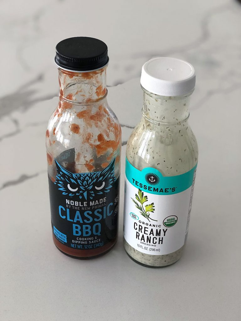 Bottles of The New Primal Classic BBQ and Tessemae's Creamy Ranch