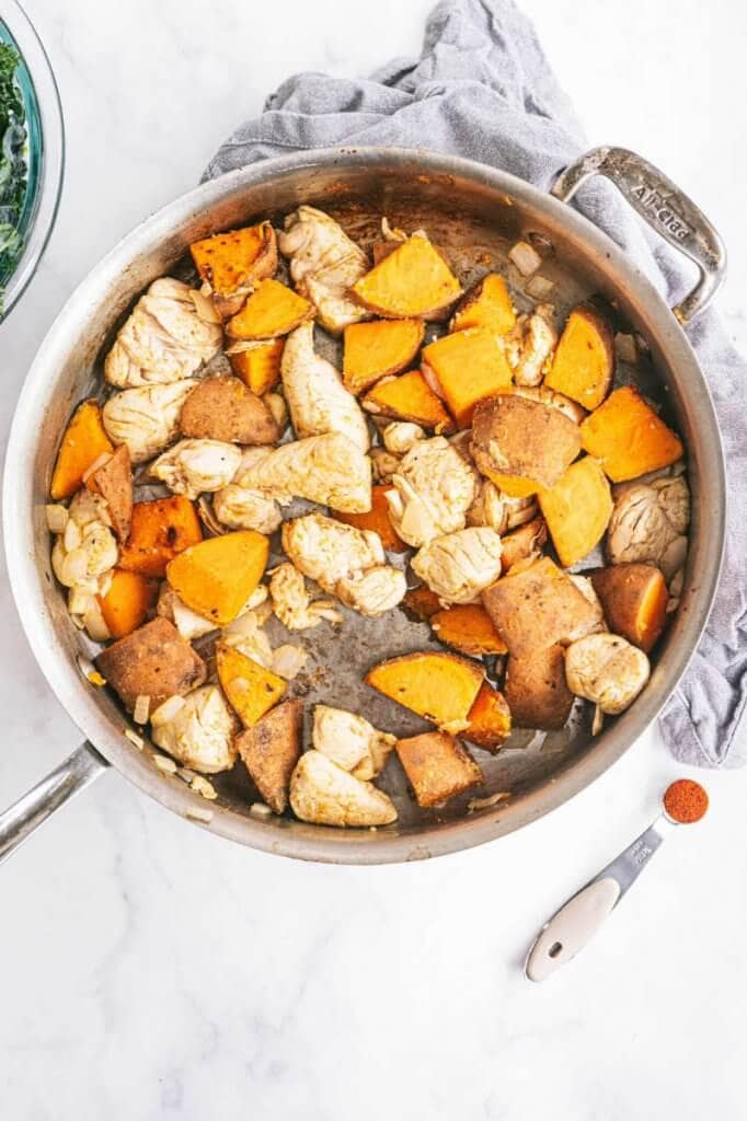 Skillet filled with chicken sweet potato and chipotle chili powder
