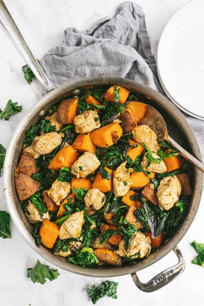 Skillet filled with kale, sweet potato and chicken