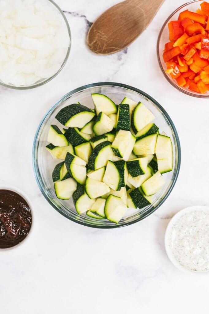 Ingredients for Turkey Skillet with vegetables including zucchini sauces and red peppers