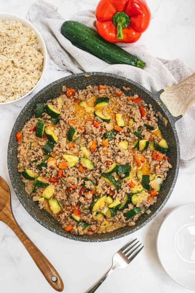 Pan with turkey skillet with veggies in it.