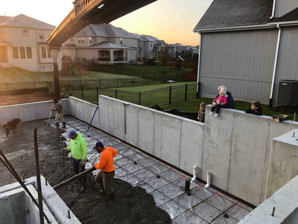 A crew pouring a basement of a families dream home
