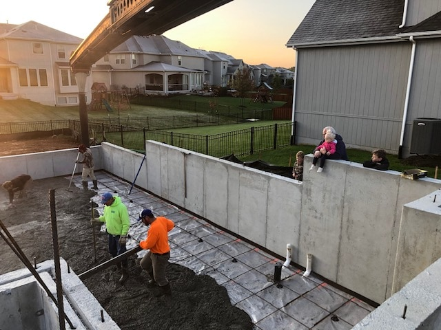 Foundation being poured with concrete at a new house