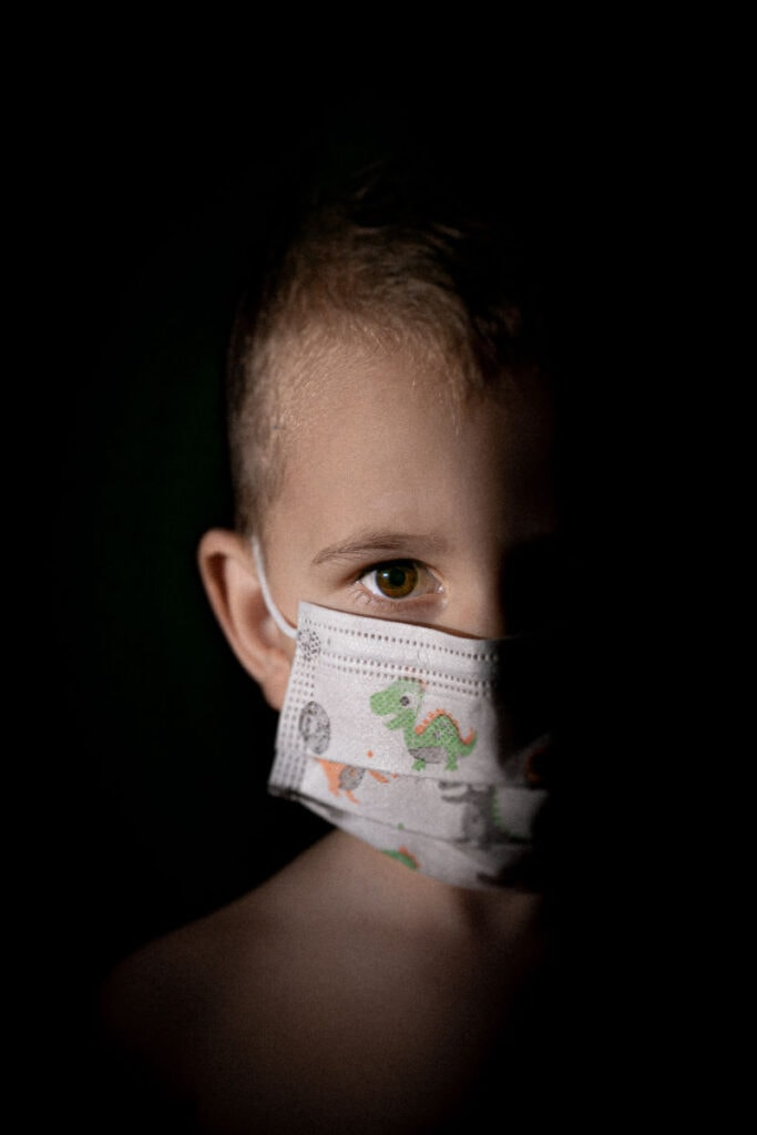 a child with a face mask on